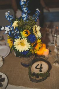 rustic blue and yellow sunflower centerpiece