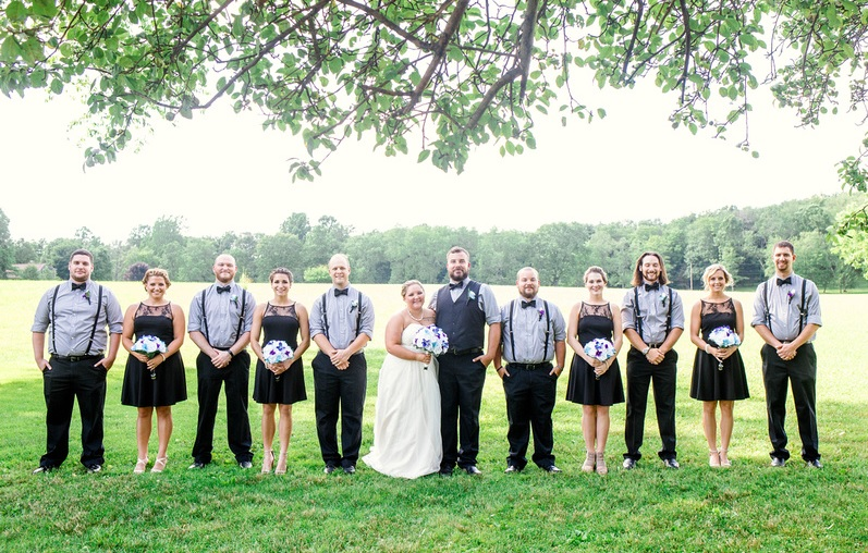 bridal party holding bouquet at foggy mountain wedding