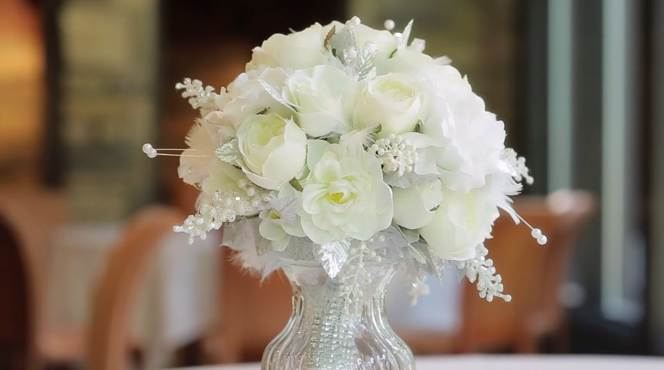 cream peony and rose wedding bouquet in a crystal vase