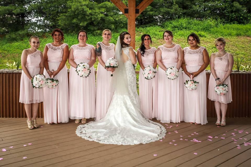 bride and bridesmaids in pink pose at the chadwick following a wedding