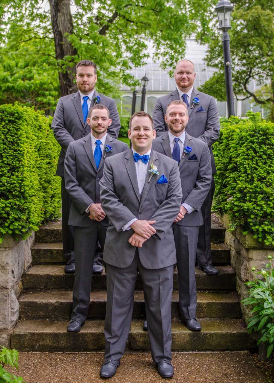 groom and groomsmen posed on the stairs at phipps conservatory