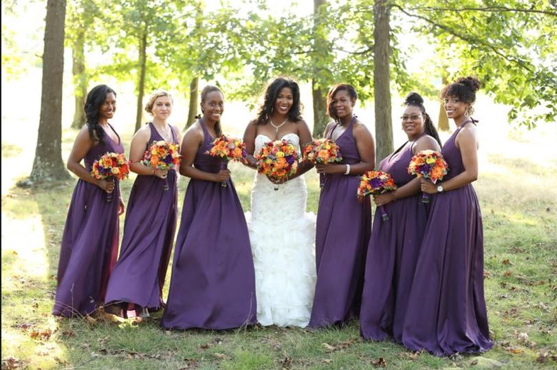 bride with bridesmaids plum fall flowers at chestnut ridge golf resort