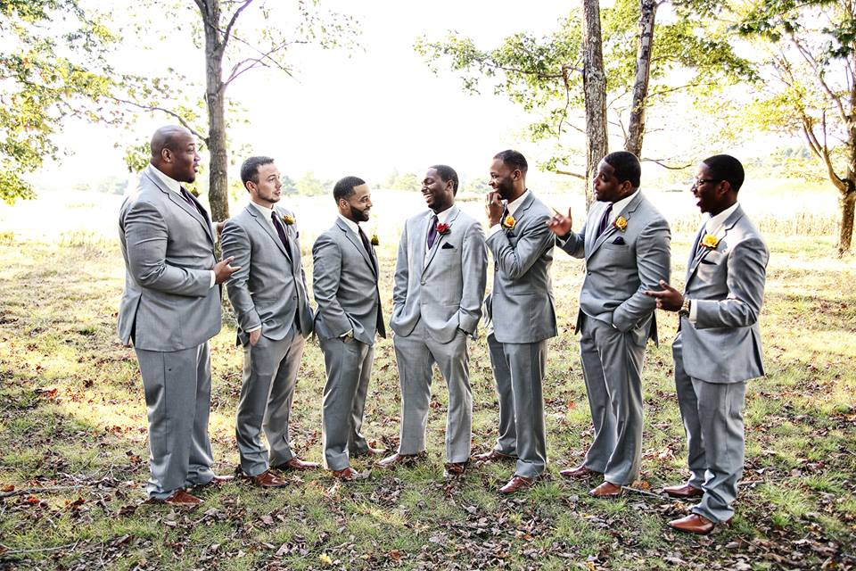 groom and groomsmen laughing at chestnut ridge golf course wedding