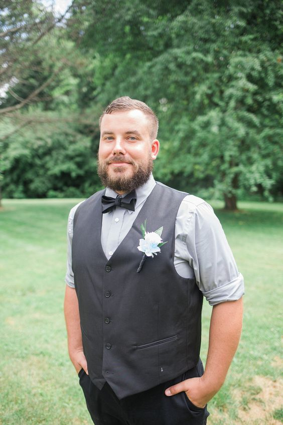 groom with boutonniere summer wedding at foggy mountain lodge