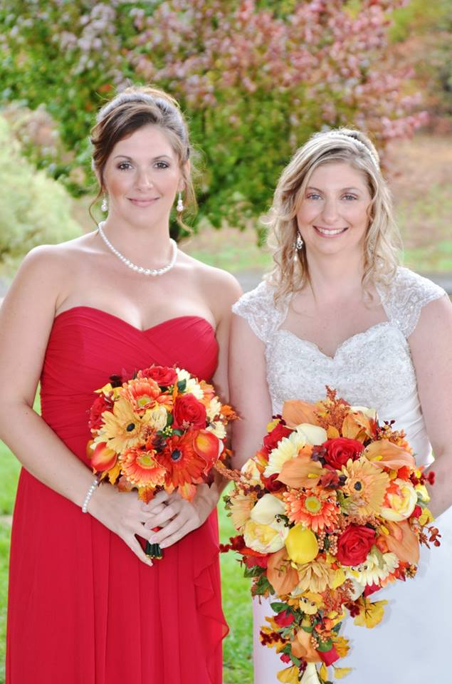 bride and bridesmaid show off bouquets during october wedding