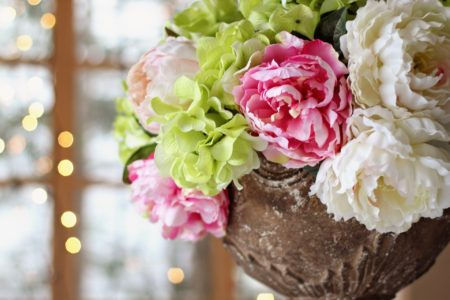 pink, green, and cream peonies and hydrangeas centerpiece at wedding reception