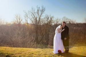 bride and groom outdoors with sun flare