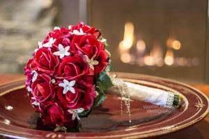 red rose real touch bouquet on table