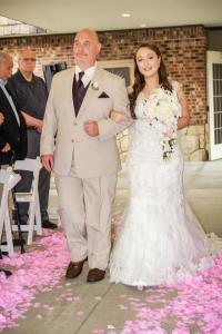 father walking bride down the aisle at an outdoor ceremony at the chadwick