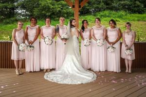 bride with bridesmaids in petal pink at the chadwick